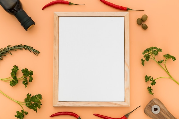 Flat lay of blank menu paper with olive oil and chili peppers