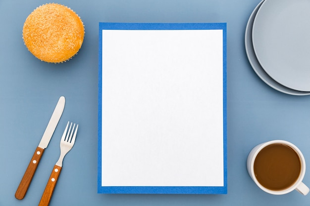 Flat lay of blank menu paper with plates and coffee