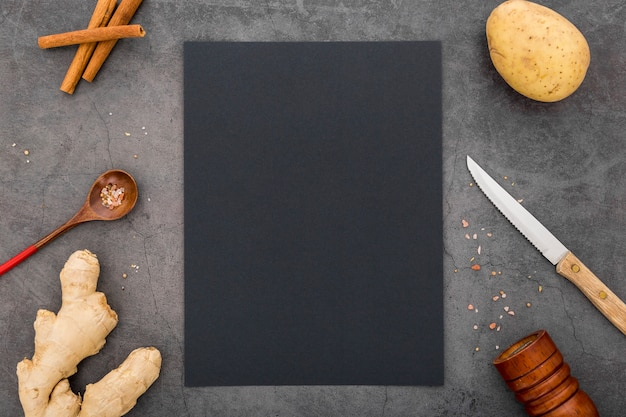Flat lay of blank menu paper with potato and ginger