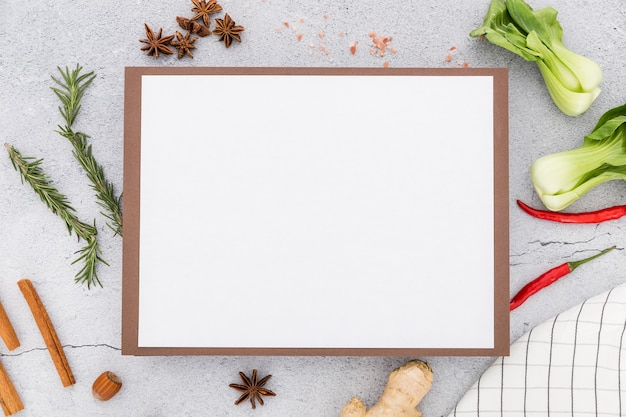 Flat lay of blank menu with ginger and celery