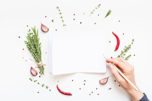 Flat lay blank notebook pages mockup text space on white background greens herb spices