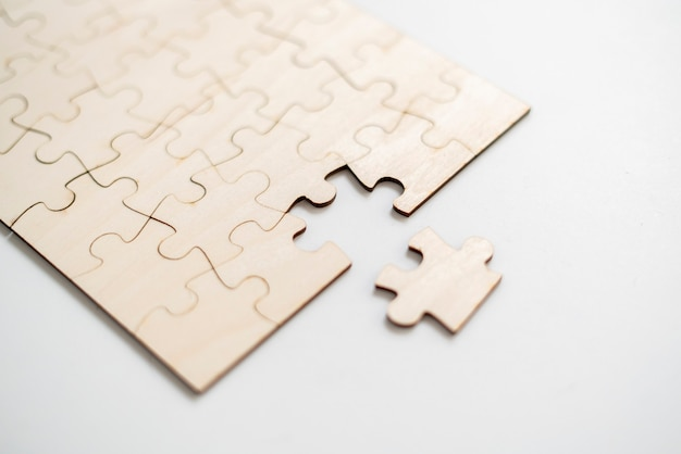 A flat lay of blank puzzle jigsaw, solution and desiciion making concept