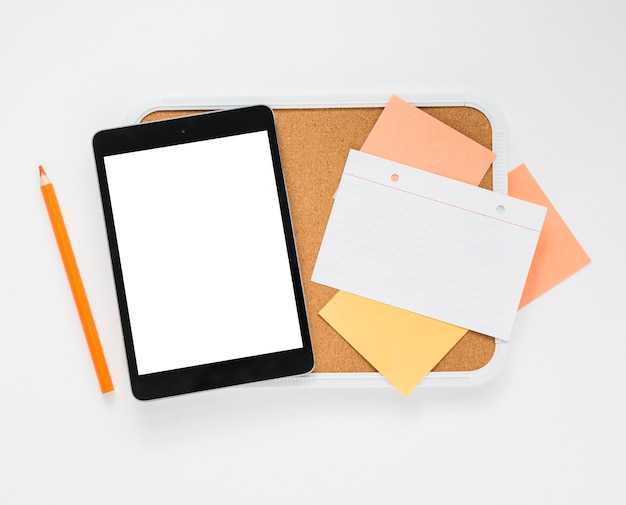 Flat lay of blank tablet and notes