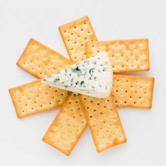 Flat lay blue cheese on crackers