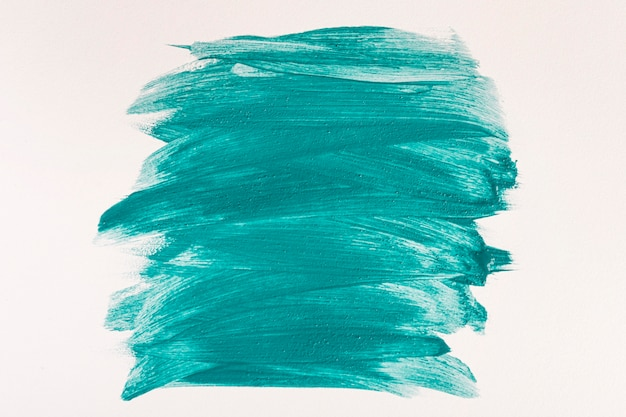 Flat lay of blue paint brush strokes on surface