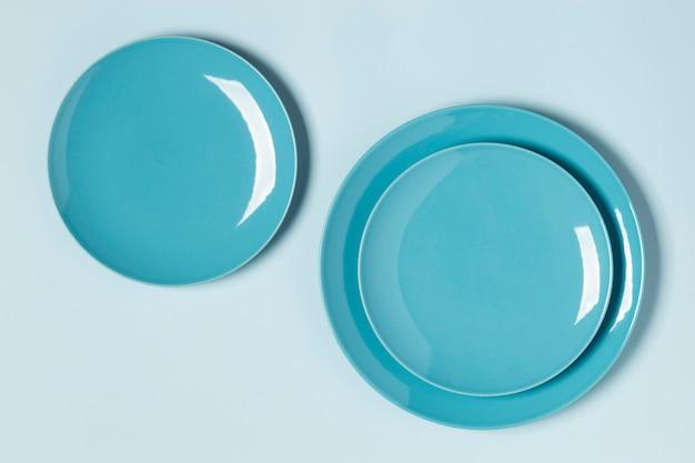 Flat lay blue plates arrangement