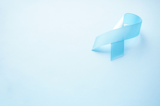 Flat lay of the blue ribbon as symbol of diabetes