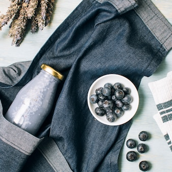 Flat lay blue smoothie and apron