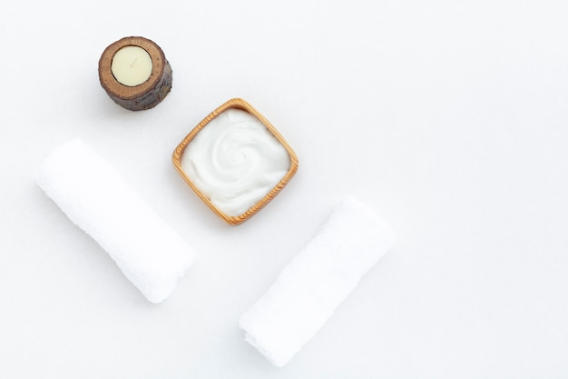 Flat lay of body butter cream on white background