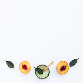 Flat lay of body butter and nectarines with copy space