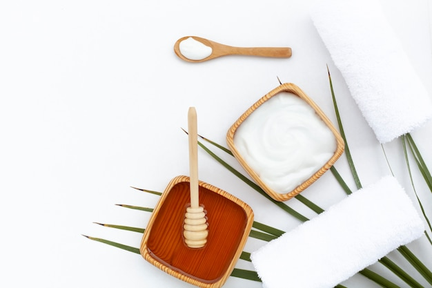 Flat lay of body butter on white background