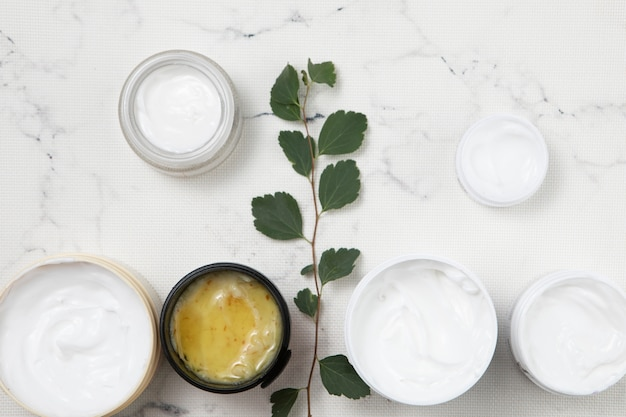 Flat lay body cream arrangement on marble background