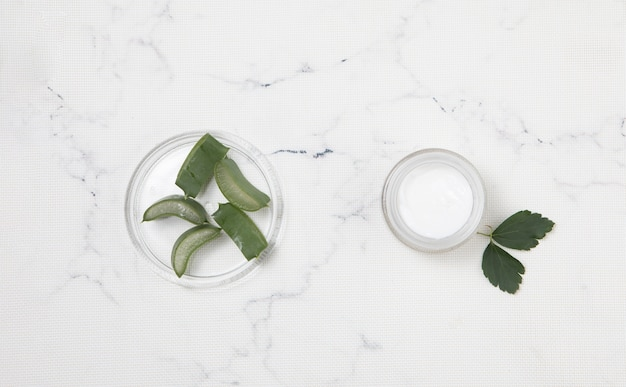 Flat lay body cream on marble background