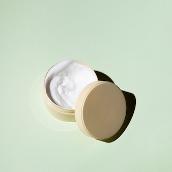 Flat lay body cream on plain background