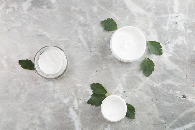 Flat lay body cream products on marble background