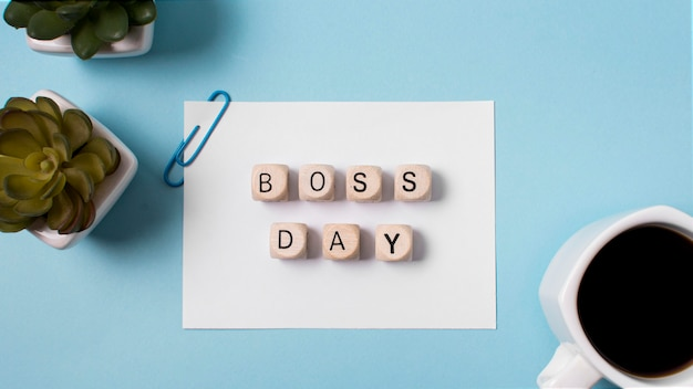 Flat lay boss's day arrangement on blue background