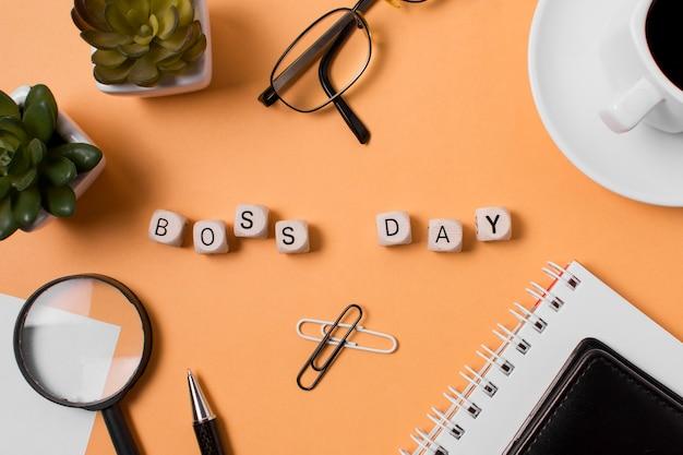 Flat lay boss's day arrangement on orange background
