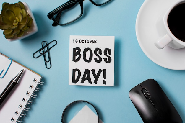 Flat lay boss's day assortment on blue background