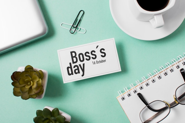 Flat lay boss's day assortment on light blue background