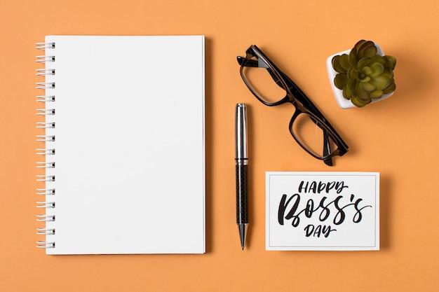 Flat lay boss's day assortment on orange background