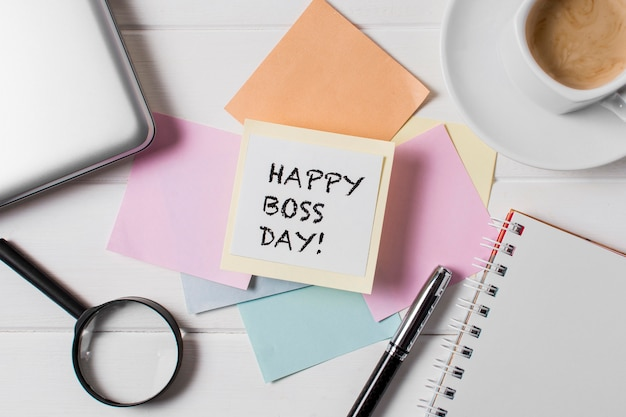 Flat lay boss's day assortment with sticky notes