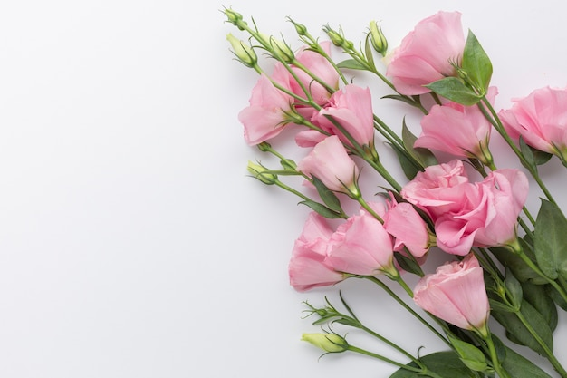 Flat lay bouquet of pink roses with copy space