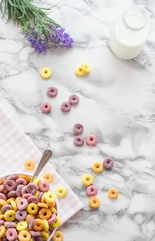 Flat lay bowl of colorful breakfast cereals.