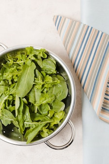 Flat lay of bowl of salad on cloth