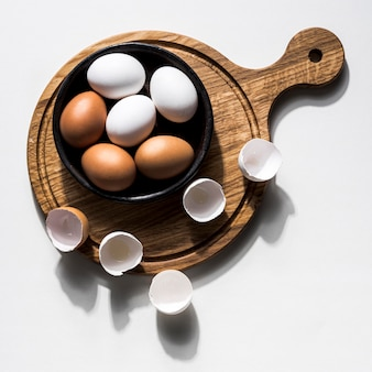 Flat lay bowl with chicken eggs