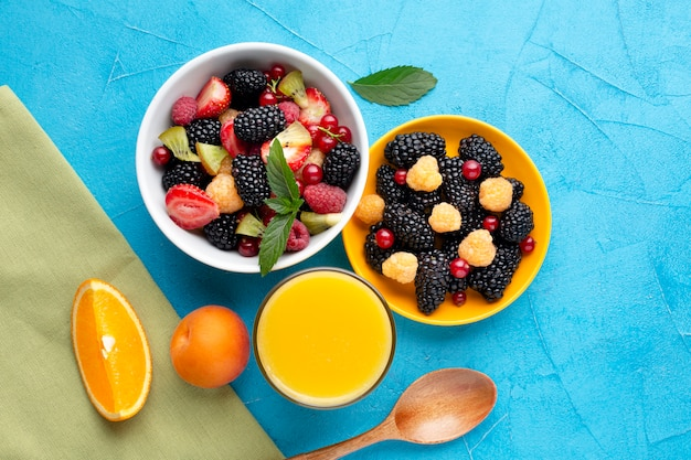 Flat-lay of bowls of berries and fruits