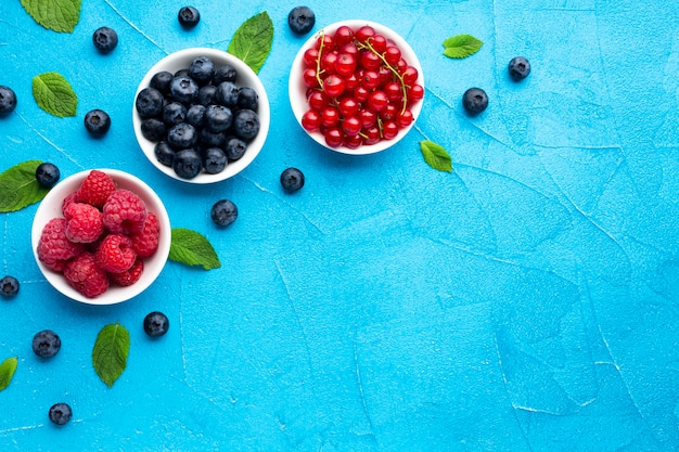 Flat-lay of bowls of berries with copy space