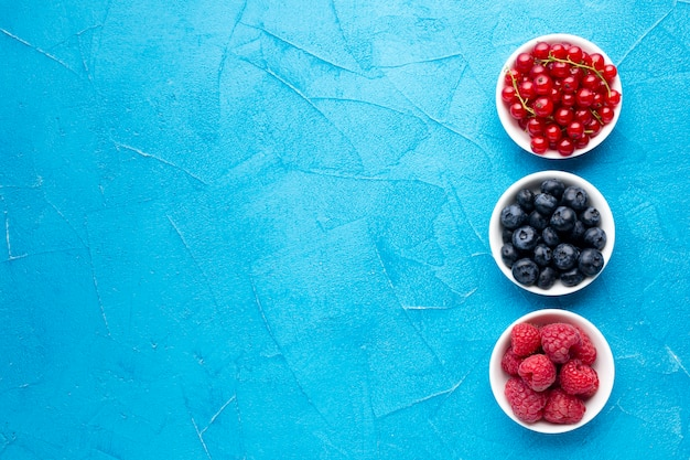 Flat lay of bowls of berries with copyspace