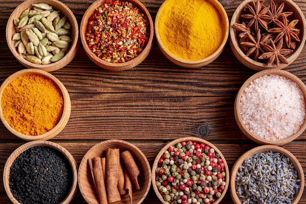 Flat lay of bowls with assortment of spices