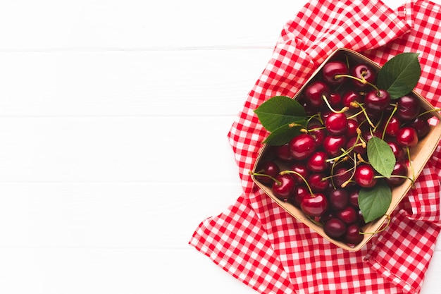 Flat-lay box of berries on tablecloth