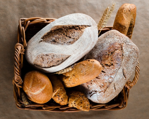 Flat lay of bread and croissants in basket