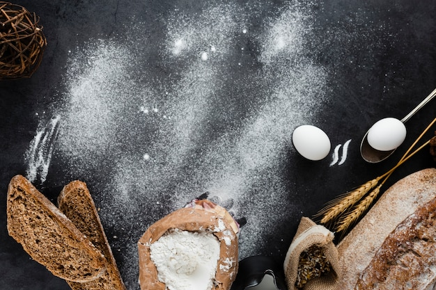 Flat lay of bread ingredients with copy space