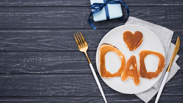 Flat lay bread letters for father's day copy space