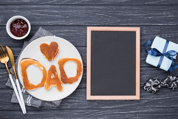 Flat lay bread letters for father's day and frame