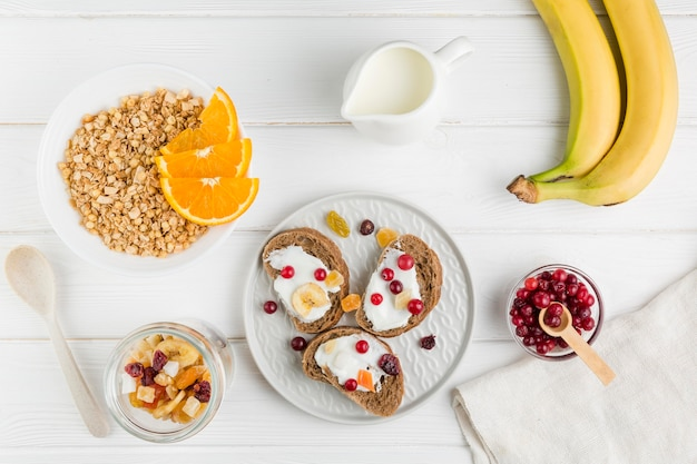 Flat lay bread slices with yogurt and fruits