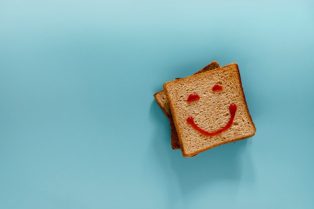 Flat lay of bread with smiling face