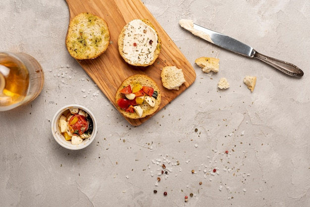 Flat lay of bread with tomatoes on chopper