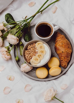 Flat lay of breakfast bowl with cereal and macarons