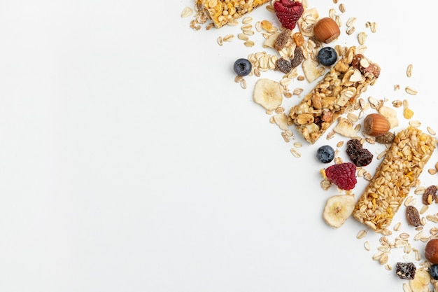Flat lay of breakfast cereal bars with fruits