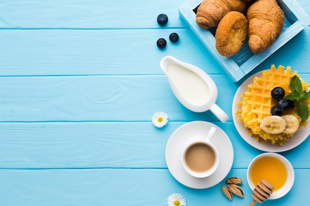 Flat lay breakfast table with copyspace