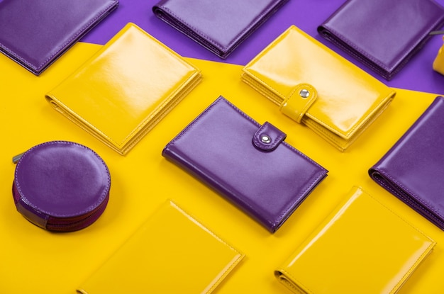 Flat lay of bright leather wallets on a matte stylish background.