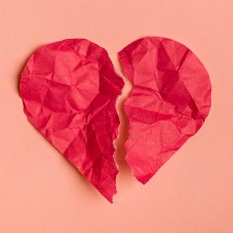 Flat lay broken paper heart