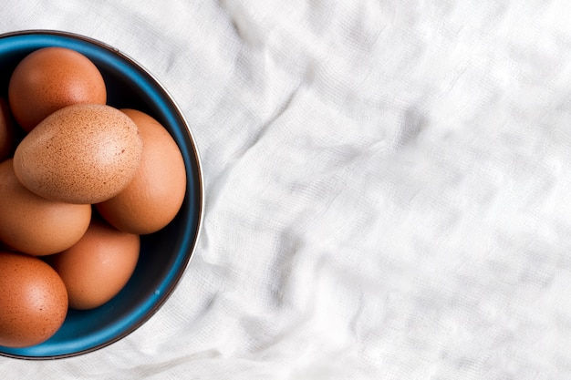 Flat lay brown eggs with copy space