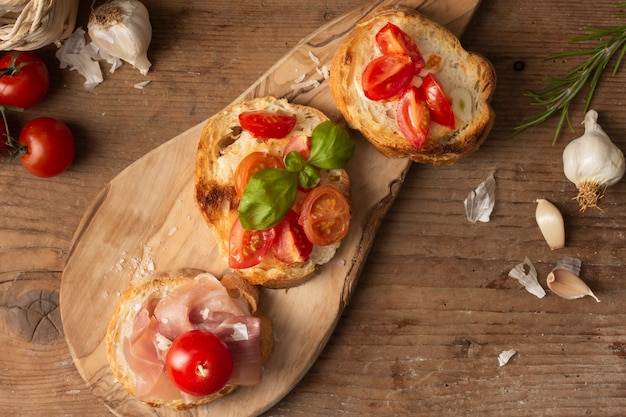 Flat lay bruschettas with prosciutto and tomatoes