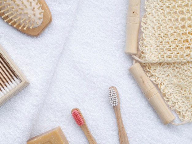 Flat lay brushes and soap on white towels
