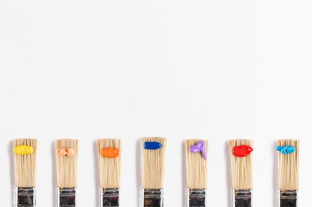 Flat lay of brushes with paint drops